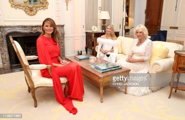 US First Lady Melania Trump Britain's Camilla Duchess of Cornwall and Suzanne Ircha wife of the US Ambassador attend a dinner at Winfield House the...