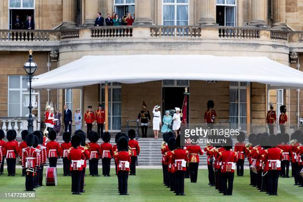 US First Lady Melania Trump Britain's Queen Elizabeth II and Britain's Camilla Duchess of Cornwall stand on the west steps during a welcome ceremony...