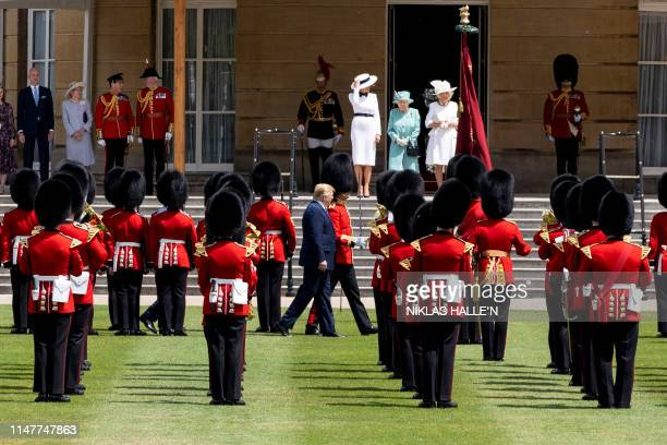 US First Lady Melania Trump Britain's Queen Elizabeth II and Britain's Camilla Duchess of Cornwall stand on the west steps as US President Donald...