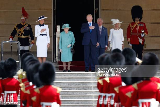 TOPSHOT US First Lady Melania Trump Britain's Queen Elizabeth II US President Donald Trump Britain's Prince Charles Prince of Wales and Britain's...