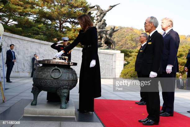 First lady Melania Trump burns incense at the National Cemetery on November 8 2017 in Seoul South Korea Trump is in South Korea as a part of his...