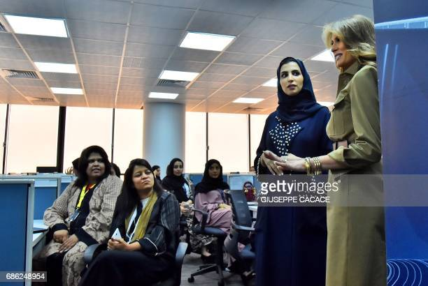 First Lady Melania Trump chats with employees during a visit to the GE AllWomen Business Process Services and IT Centre on May 21 in the Saudi...