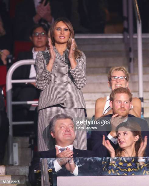 First Lady Melania Trump cheers for the USA team with Prince Harry during the opening ceremony of the 2017 Invictus Games at Air Canada Centre on...