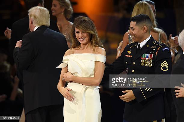 First Lady Melania Trump dances with a member of the Marine Corps during the Salute to Our Armed Services Inaugural Ball at the National Building...