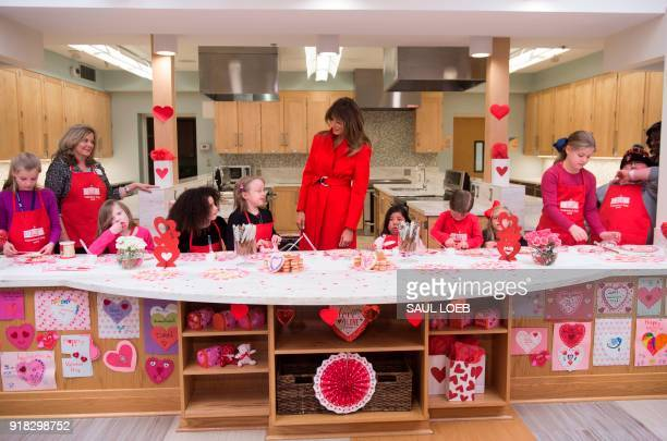 US First Lady Melania Trump decorates cookies for Valentine's Day as she visits with children who are currently patients at the National Institutes...
