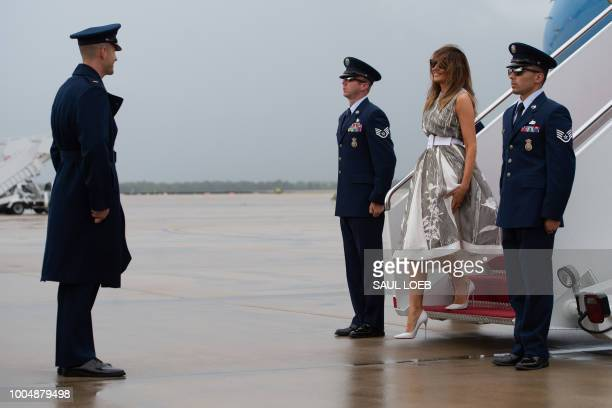 US First Lady Melania Trump disembarks from a military airplane upon arrival at Joint Base Andrews in Maryland July 24 following a trip to Nashville...