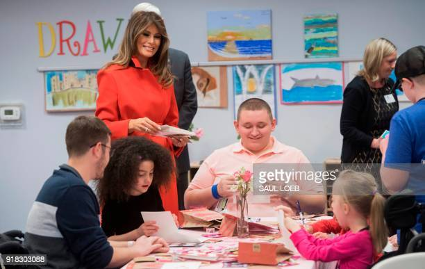 US First Lady Melania Trump exchanges valentines for Valentine's Day as she visits with children who are currently patients at the National...