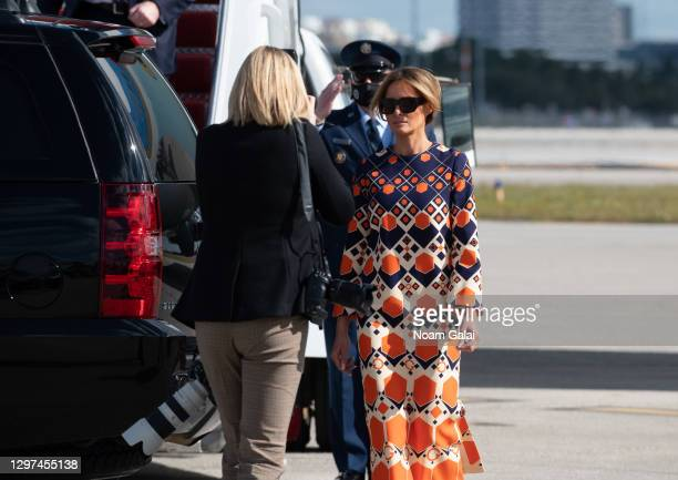 First Lady Melania Trump exits Air Force One at the Palm Beach International Airport on the way to Mar-a-Lago Club on January 20, 2020 in West Palm...