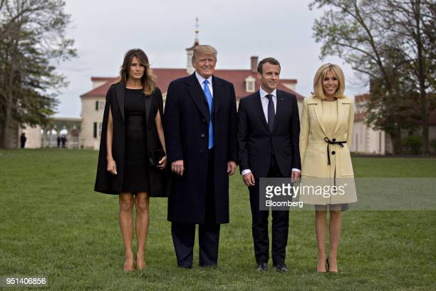 S First Lady Melania Trump from left US President Donald Trump Emmanuel Macron France's president and Brigitte Macron France's first lady stand for...