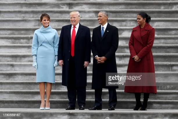 First Lady Melania Trump, from left, U.S. President Donald Trump, former President Barack Obama, and former First Lady Michelle Obama stand on the...
