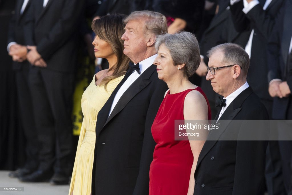 U.S. First Lady Melania Trump, from left, U.S. President Donald Trump, Theresa May, U.K. prime minister, and her husband Philip May watch a live military performance by the bands of the Scots, Irish and Welsh Guards ahead of a dinner at Blenheim Palace, in Oxfordshire, U.K., on Thursday, July 12, 2018. Trump and the first lady will meet British business leaders at the black-tie dinner attended by more than 100 guests. Photographer: Will Oliver/Pool via Bloomberg