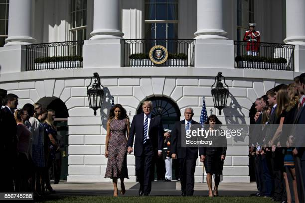 US First Lady Melania Trump from left US President Donald Trump US Vice President Mike Pence and US Second Lady Karen Pence walk to participate in a...
