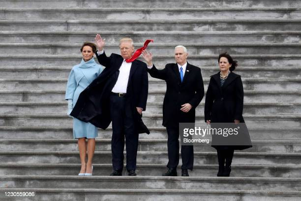 First Lady Melania Trump, from left, U.S. President Donald Trump, Vice President Mike Pence, and Second Lady Karen Pence wave on the West Front of...