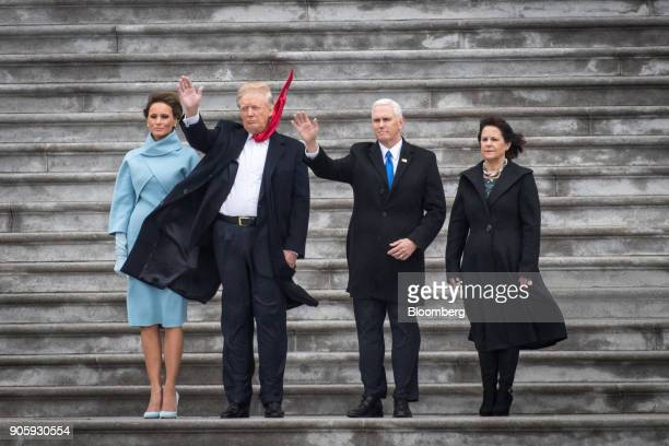 S First Lady Melania Trump from left US President Donald Trump Vice President Mike Pence and Second Lady Karen Pence wave on the West Front of the US...