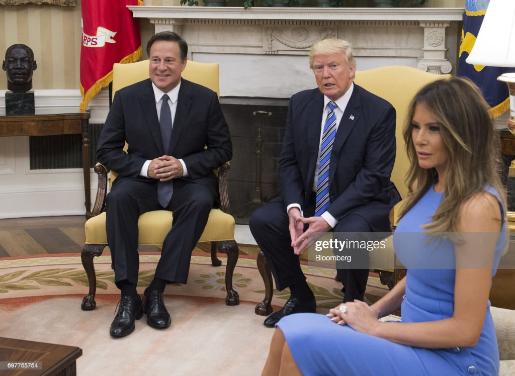 U.S. First Lady Melania Trump, from right, U.S. President Donald Trump, and Juan Carlos Varela, Panama's president, sit during a meeting in the Oval Office at the White House in Washington, D.C., U.S., on Monday, June 19, 2017. The U.S. is Panama's number one source of imports, accounting for 17 percent or $4.68 billion of the country's total imports, according to Massachusetts Institute of Technology's Observatory of Economic Complexity. Photographer: Molly Riley/Pool via Bloomberg