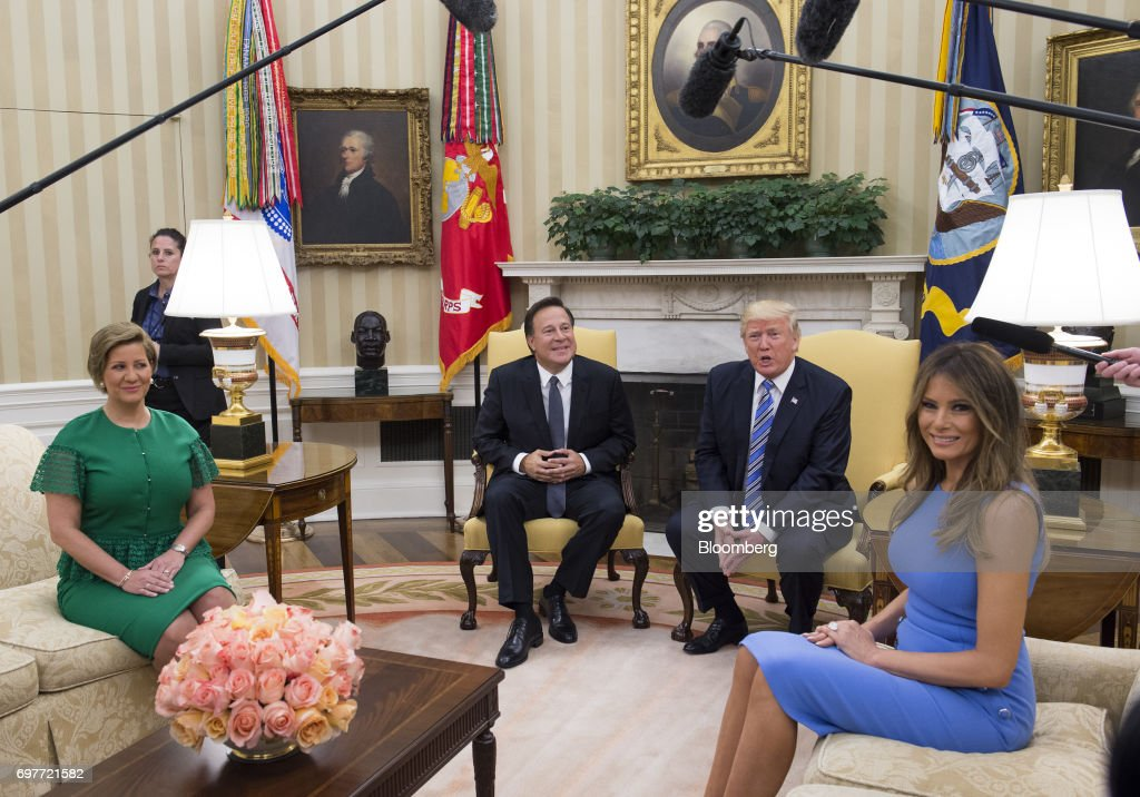 U.S. First Lady Melania Trump, from right, U.S. President Donald Trump, Juan Carlos Varela, Panama's president, and Lorena Castillo Garca de Varela, first lady of Panama, sit for photographs during a meeting in the Oval Office at the White House in Washington, D.C., U.S., on Monday, June 19, 2017. The U.S. is Panama's number one source of imports, accounting for 17 percent or $4.68 billion of the country's total imports, according to Massachusetts Institute of Technology's Observatory of Economic Complexity. Photographer: Molly Riley/Pool via Bloomberg