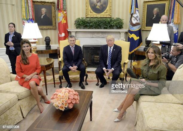 US First Lady Melania Trump from right US President Donald Trump Mauricio Macri Argentina's president and Juliana Awada first lady of Argentina sit...