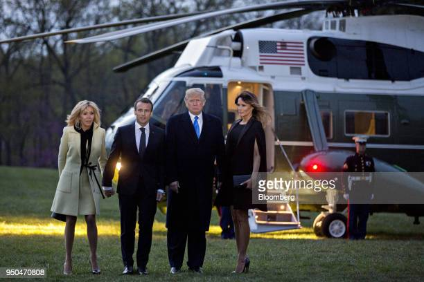 US First Lady Melania Trump from right US President Donald Trump Emmanuel Macron France's president and Brigitte Macron France's first lady stand for...