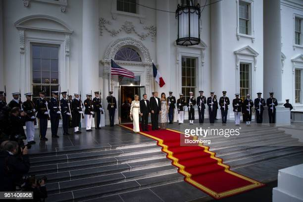 S First Lady Melania Trump from right US President Donald Trump Emmanuel Macron France's president and Brigitte Macron France's first lady stand for...