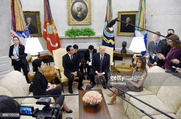 US First Lady Melania Trump from right US President Donald Trump Prayuth ChanOcha Thailand's prime minister and his wife Naraporn ChanOcha sit during...