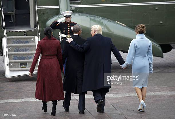 US First Lady Melania Trump from right US President Donald Trump walks with former President Barack Obama and former First Lady Michelle Obama...