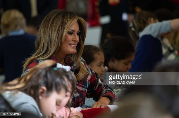 US First Lady Melania Trump gives attends a a Toys for Tots event at Joint Base AnacostiaBolling in Washington DC on December 11 2018 Toys for Tots...
