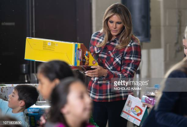 US First Lady Melania Trump gives presents at a Toys for Tots event at Joint Base AnacostiaBolling in Washington DC on December 11 2018 Toys for Tots...