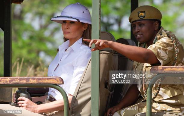 US First Lady Melania Trump goes on a safari with Nelly Palmeris Park Manager at the Nairobi National Park in Nairobi October 5 during the third leg...