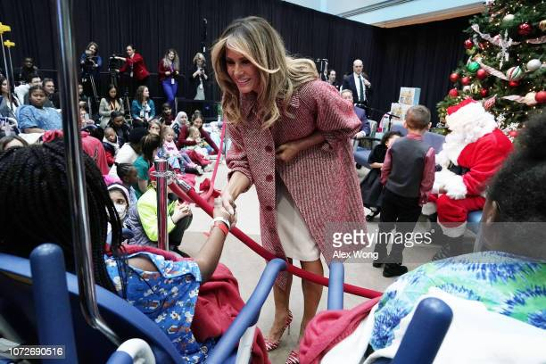 S first lady Melania Trump greets children patients after reading aloud the story 'Oliver the Ornament' during a visit to the Children's National...