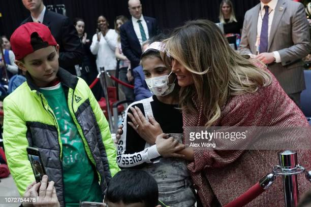 S first lady Melania Trump greets children patients after reading the story 'Oliver the Ornament' during a visit to the Children's National Hospital...