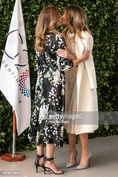 First Lady Melania Trump greets First Lady of Argentina Juliana Awada during a guided visit to MALBA as part of G20 Partners' Programme on December...