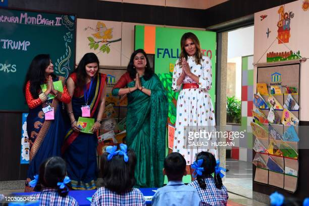 First Lady Melania Trump greets in a classroom with teachers and students during her visit at Sarvodaya CoEd Senior Secondary School in New Delhi on...