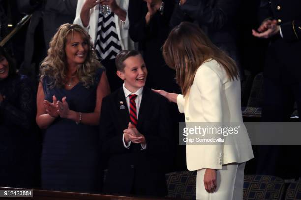First lady Melania Trump greets Preston Sharp during the State of the Union address in the chamber of the US House of Representatives January 30 2018...