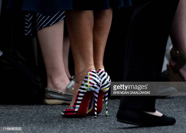 US First Lady Melania Trump greets supporters after stepping off from Marine One on the lawn of the White House on June 7 in Washington DC