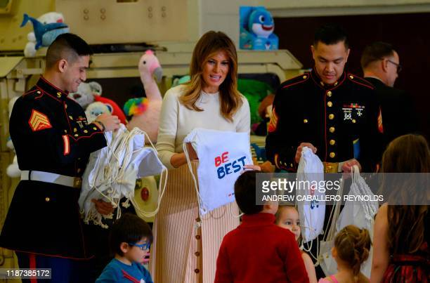 US First Lady Melania Trump hands out 'Be Best' bags during the annual Marine Toys for Tots program hosted by the US Marine Corps Reserve at Joint...