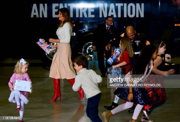 US First Lady Melania Trump hands out toys during the annual Marine Toys for Tots program hosted by the US Marine Corps Reserve at Joint Base...