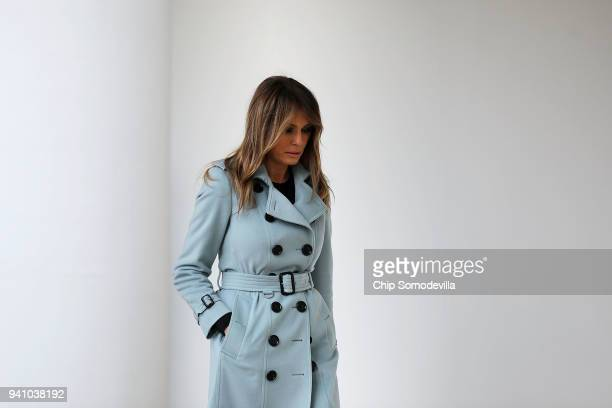 First lady Melania Trump heads back into the White House after hosting the 140th annual Easter Egg Roll on the South Lawn April 2, 2018 in...