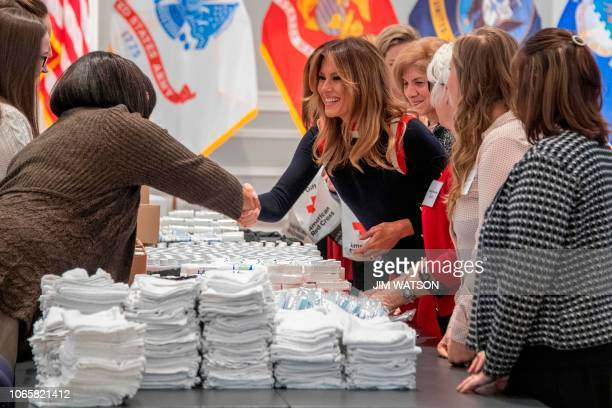 US First Lady Melania Trump helps assembles care packages for US troops stationed abroad for the holidays at The American Red Cross National...
