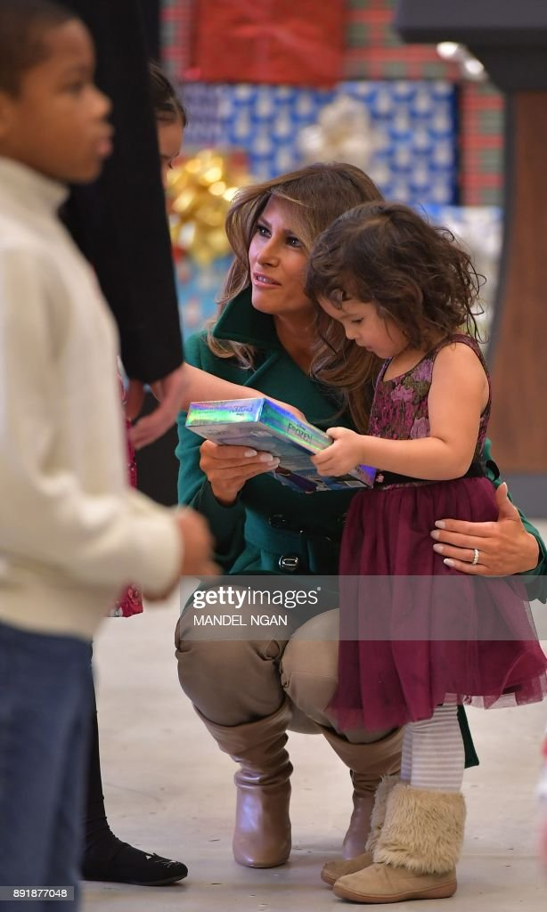 US First Lady Melania Trump helps chats with children sorting toys for the Marine Corps Reserve Toys for Tots Campaign at Joint Base Anacostia-Bolling in Washington, DC on December 13, 2017 /