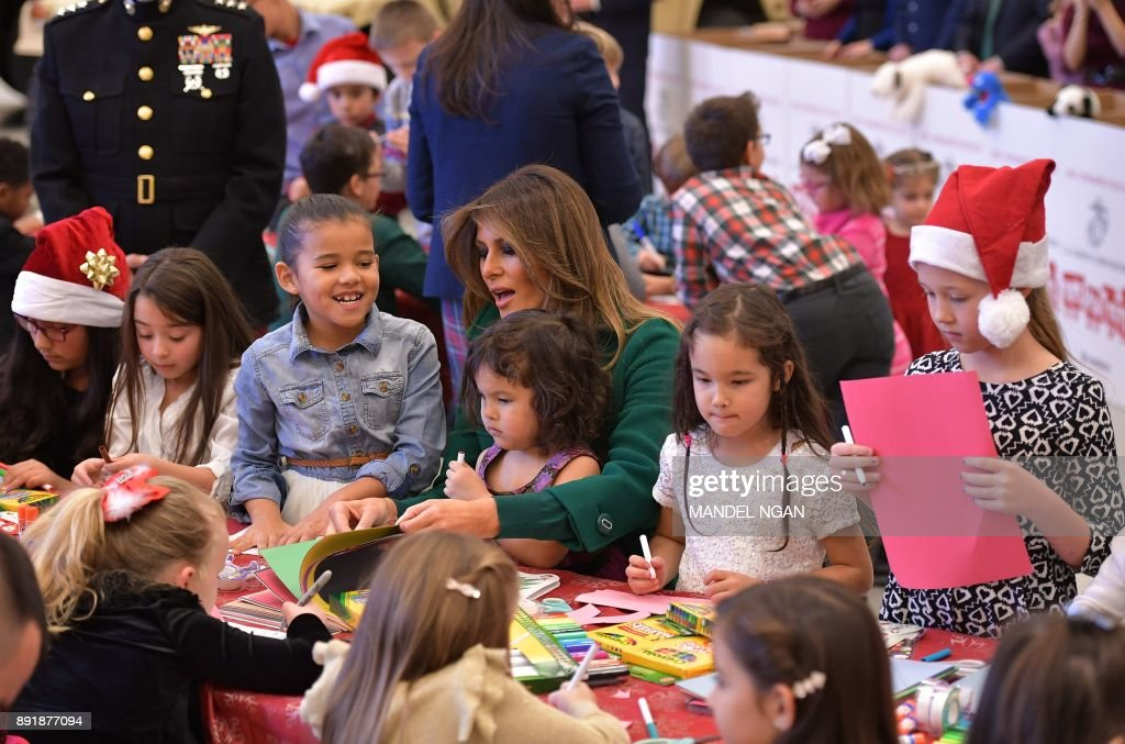 US First Lady Melania Trump helps children make Christmas cards with the Marine Corps Reserve Toys for Tots Campaign at Joint Base Anacostia-Bolling in Washington, DC on December 13, 2017 /