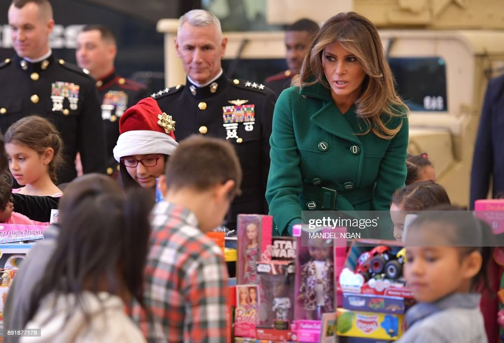 US First Lady Melania Trump helps children sort toys for the Marine Corps Reserve Toys for Tots Campaign at Joint Base Anacostia-Bolling in Washington, DC on December 13, 2017. /