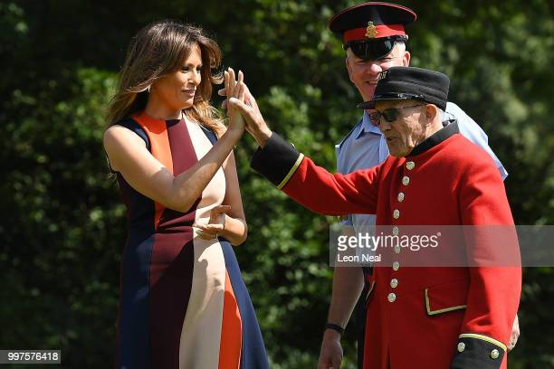 First Lady, Melania Trump, high-fives a Chelsea Pensioners as she tries her hand at bowls as she meets British Army veteransat Royal Hospital Chelsea...