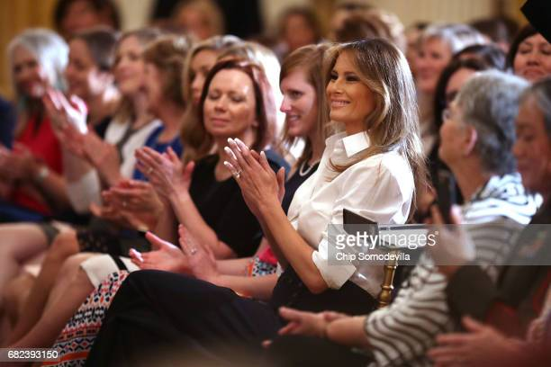 S first lady Melania Trump hosts an event for military mothers on National Military Spouse Appreciation Day in the East Room at the White House May...
