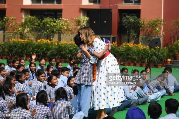 US First Lady Melania Trump hugs a student during her visit at Sarvodaya CoEd Senior Secondary School in New Delhi on February 25 2020 US President...