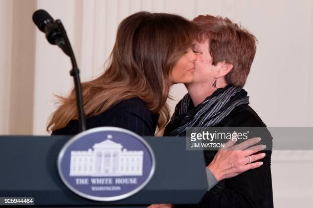 First Lady Melania Trump hugs Betty Henderson a mother who wrote to her after her 29year old son died from an opioid overdose during an event at the...