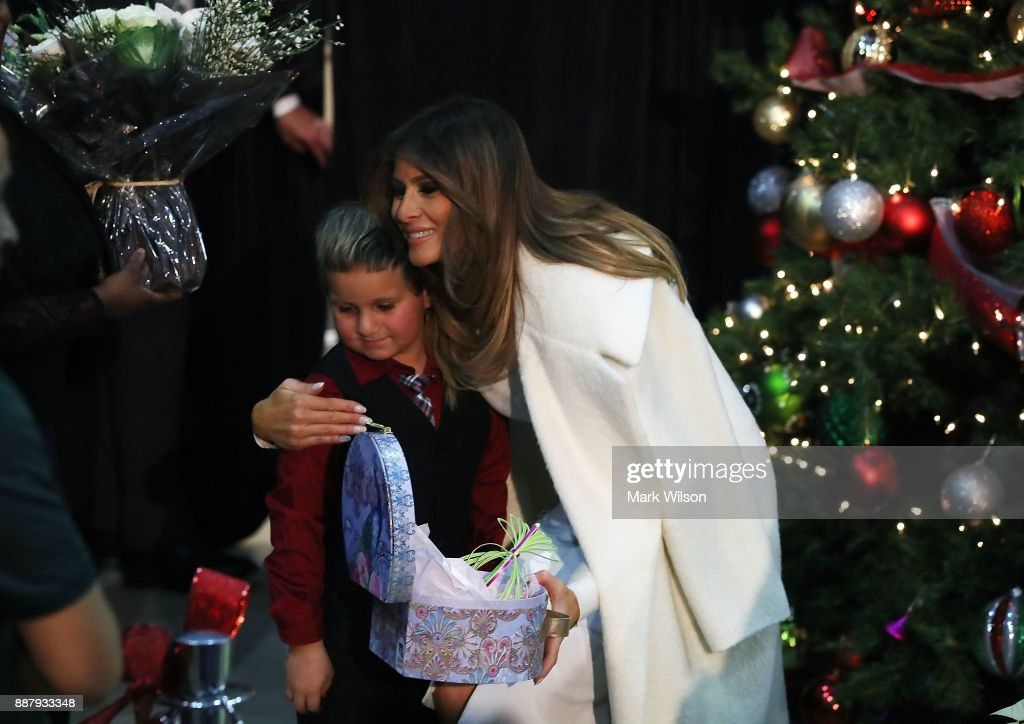 First lady Melania Trump hugs Damian Contreras during a visit to Children's National Medical Center, on December 7, 2017 in Washington, DC. First ladies dating back to Jacqueline Kennedy have made the annual visit to the Washington area hospital during the holiday season.