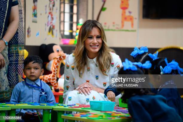 US First Lady Melania Trump interacts with students in a classroom during her visit at Sarvodaya CoEd Senior Secondary School in New Delhi on...
