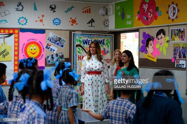 US First Lady Melania Trump interacts with teachers and students in a classroom during her visit at Sarvodaya CoEd Senior Secondary School in New...