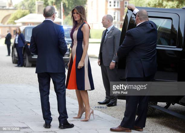S First Lady Melania Trump is accompanied by Philip May the husband of British Prime Minister Theresa May as she arrives to meet British military...
