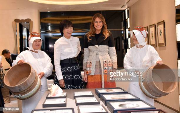 US First Lady Melania Trump Japanese First Lady Akie Abe and Ama divers visit the Mikimoto Pearl head shop in Ginza district of Tokyo on November 5...